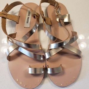 Steve Madden gold gladiator style sandals.